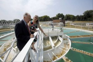Elgin Water Director Kyla Jacobsen leads former Elgin City Manager Leo Nelson on a tour