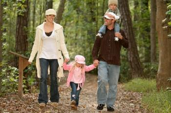 family on a woodland trail